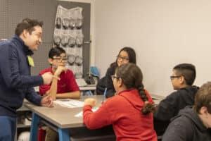 Edgar Palacios in the classroom with Latinx students